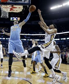 Description of . Denver Nuggets center Jusuf Nurkic, left, blocks a shot by New Orleans Pelicans forward Anthony Davis during the first half of an NBA basketball game in New Orleans, Wednesday, Jan. 28, 2015. (AP Photo/Gerald Herbert)