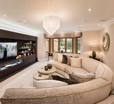 A mansion interior nominated for a prestigious SB ID award! In the Cinema Room, a Atlas sofa in Kai Adorna Gold & Beige takes centre-stage, providing seating for the whole family. The curved sofa is the perfect piece to make this family room an inv Mansion Interior, Home Interior, Interior Design, Mansion Rooms, Home Cinema Room, Home Theater Rooms, Home Design, Home Theater Design, Luxury Rooms