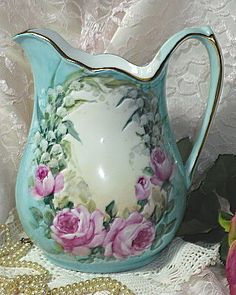 Hand painted roses pitcher.