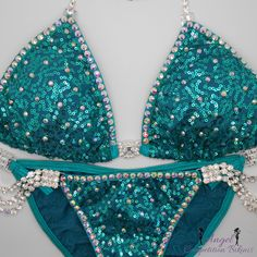 Angel Bliss with crystal ab trim on sequin teal
