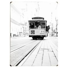 Wood wall art depicting a black and white image of a trolley car.   Product: Wall artConstruction Material: Wood ...