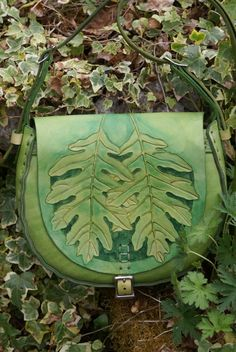 hand-tooled green leather bag with oak leaves