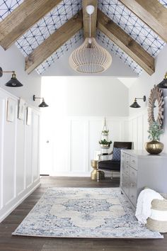 Wallpaper ceiling with wood ceiling beams in hallway. Hallway Ceiling, Ceiling Decor, Ceiling Design, Ceiling Lighting, Accent Ceiling, Upstairs Hallway, White Ceiling, Hallways, Painted Beams