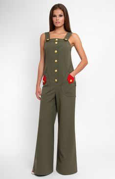 Sleeveless military style stretchy cotton overall. Button down closure. Front and back patch pockets. Bow with a designer handmade rose. Unlined.