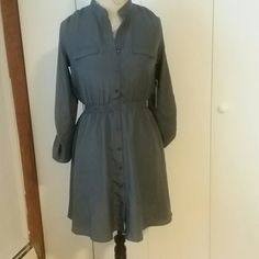 Grey silky dress Grey dress. Long sleeves with buttons on them. Button up the front dress. Dresses Midi