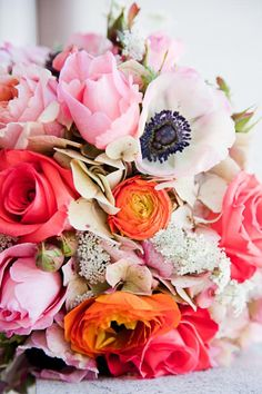 Feminine bouquet with warm, lush colors.