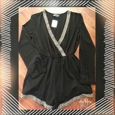 """Romper  Romper with dark silver beading around the bottom of the legs and the neckline.  Pockets in the front. Long sleeves with a button closure.   The shorts are even lined!  100% Polyester. Arm length is 24"""", Waist measurement unstretched is 24"""" stretched is 34"""".  Short length is 13"""". Back romper lefty is 31"""". Side romper length is 20"""" Perfect for that special date night  ASTR - Nordstrom Other"""