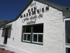 """Die Kliphuis"" restaurant Melkbosstrand, Cape Town.    A little house built in 1923 transformed into a lovely restaurant by the sea."