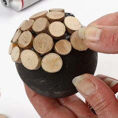 These beautiful polystyrene balls are painted with black craft paint and then covered with small wooden discs which are glued o...