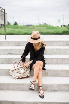 Krystal Schlegel summer panama hat, little black day dress, and lace-up heels.