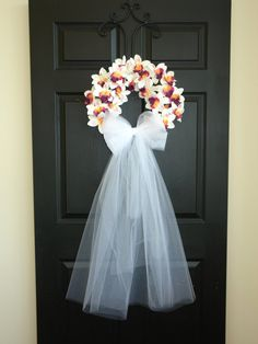 wedding wreath, wedding decor spring summer wreath wedding wreaths for front door wreath decorations decor flowers This listing is for beautiful wedding front door decor. The perfect front door or wall decor, wedding decorations. This decoration is made with artificial orchids and white tule bow and veil. Measures: wreath measure across 16, veil 30 long, or veil 55 long(reach to the bottom of the door). International shipping available, please ask me for correct shipping cost. See my othe...
