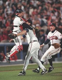 Chipper Jones joins Mark Wohlers and Javy Lopez in front of the mound after the last out of the 1995 World Series. (18 photo highlights of Chipper's career)