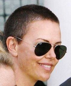 Charlize Theron buzzed hair looking bad ass
