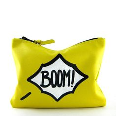 15 Cool Travel Cosmetics Bags - Bright Yellow 'BOOM!' Love, Cortnie Comic Mini Statement Clutch ($55) - guaranteed to not get lost at the bottom of your luggage.