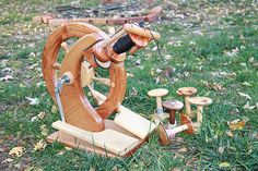 """Wee Spin"" tiny handmade spinning wheel. Footprint measures 8.5"" x 12"", wheel is 16"" high, with another inch or two for the flyer."
