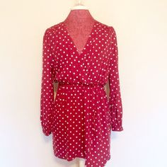 Red & White Polkadot LongSleeved Dress In perfect condition. Cinched waist makes it so flattering with the deep v neckline. Soft, silky and so comfortable. Please use the offer button. No trades. Boutique Dresses Long Sleeve
