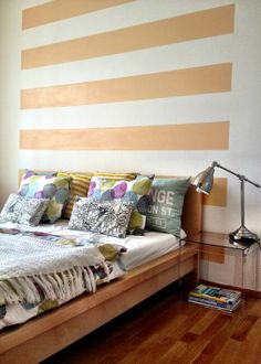I like this colour blocking of part of the wall Would work well even with a head board or with couch