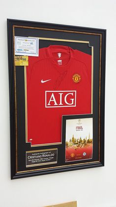 86c1c303b7e Cristiano Ronaldo of Manchester United Signed shirt OFFICIAL CHAMPIONS  LEAGUE PROGRAMME DISPLAY  Amazon.co