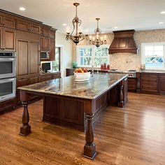 kitchen island- love the posts, plenty of seating. imagine having room for that