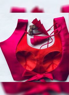 Presenting this party wear rani pink color silk base designer backless pattern blouse. Choli Designs, Saree Jacket Designs, Choli Blouse Design, Designer Blouse Patterns, Fancy Blouse Designs, Bridal Blouse Designs, Blouse Back Neck Designs, Lehenga Designs, Designer Dresses