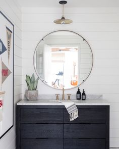 shiplap surrounding every wall in this washroom with locally crafted pennants on display... we love everything about this!…