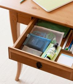 Traditional desks with drawers provide additional storage for things you would prefer to keep out of view. But the problem with drawers is precisely that everything is hidden. It's easy to put things there without thinking, and the drawers can quickly turn into clutter buckets. To make best use of your drawers and keep them as organized as possible, commit each drawer to one type of storage, and partition drawers as necessary to keep things neat.