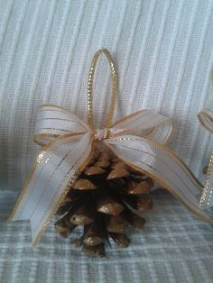 Set of three handmade golden pinecones Christmas ornaments with a bow for your Christmas tree