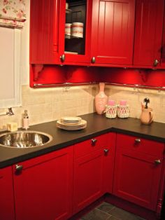 Red cabinets as apposed to red walls. I am in love with this look. I would love to use red, beige, black,  white.