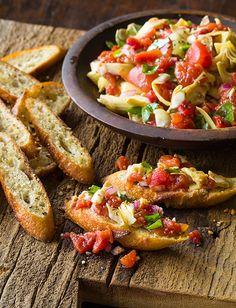 artichoke and tomato bruschetta // served with crostini Italian Gravy, Italian Spices, Bruchetta Recipe, Appetizer Recipes, Appetizers, Crostini, Artichoke Recipes, Creole Recipes, Clean Eating Snacks