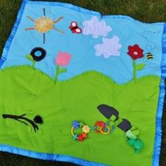 This will make tummy time way more fun!  I probably have enough fabric scraps and velcro to make this without having to purchase anything!  Love that!
