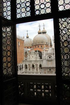 Palazzo Ducale by Deborah Guber on Flickr - Venice, Italy.  The onion shaped domes of St. Mark's Basilica as seen through a window in the Doge's Palace