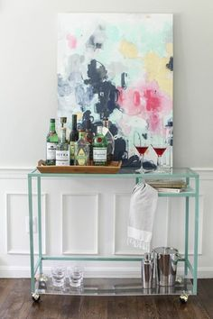 5 Smart IKEA Hacks: VITTSJÖ Projects & Transformations; I've been wanting a bar cart...I would probably wouldn't use the plexi-glass though, don't like the way it bends but other than that super cute diy idea!