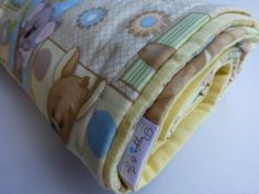 Baby Cot Blanket. Soft Cotton Australian Baby Animal Print, Soft Yellow Flannel on Reverse with Cotton Wadding insert by PeggieandJo on Etsy https://www.etsy.com/au/listing/242199190/baby-cot-blanket-soft-cotton-australian