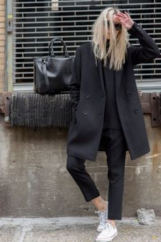 Black coat over all black with white street shoe