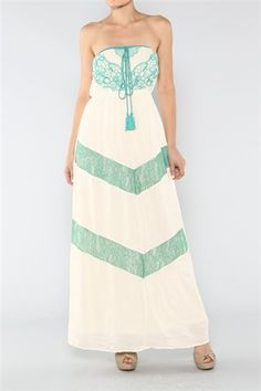 Chevron Lace Maxi Dress. Strapless ivory maxi dress features an empire bodice with embroidered details, elastic waistband, and chevron lace skirt.