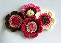 Pretty chocolate and raspberry crocheted flowers