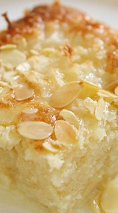 Coconut Almond Ricotta Cake ~ A magical cake that will make your mornings extra sweet... This cake has a crunchy coconut and almond top and sweet coconut milk glaze PERXFOOD.COM