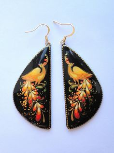 """Elegant hand painted firebird earrings   """"These elegant earrings are hand-painted in the traditional technique of Palekh lacquer miniature art. Palekh lacquer miniatures traditionally feature characters and scenes from Slavic folklore, one of them is Firebird.""""   GlobeIn"""