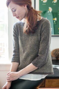 If you're already dreaming of spring, cast on a breezy modern pullover in stripes of Loft that recall the greening of furrowed fields. Stratum's bateau neck and 3/4-length dolman sleeves balance a dramatically flared skirt. Shifts from stockinette to garter stitch create sleeve shaping as well as a subtle triangular motif rising from the cuff …