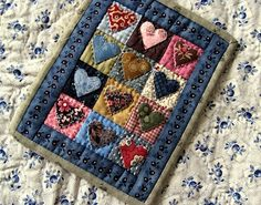 Heart mini-quilt. Image only. Can't find the image on The Sentimental Quilter…