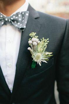 muted green bout and gray bow tie - photo by Shannen Natasha - http://ruffledblog.com/metropolitan-garden-wedding/
