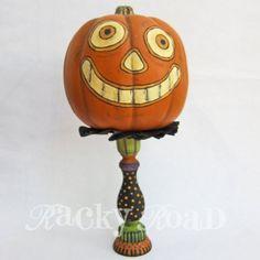 Grinning Jack o'lantern on candlestick stand (K.Batsel)