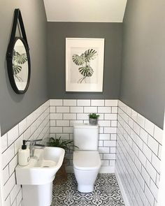 The little room with a wonderfully big tiling solution. bother the metro wall tiles with coloured grout and the patterned floor tiles. Small Downstairs Toilet, Small Toilet Room, Downstairs Cloakroom, Small Toilet Decor, Bad Inspiration, Bathroom Inspiration, Toilet Room Decor, Wc Decoration, Inexpensive Bathroom Remodel