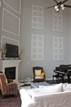 a little of this, a little of that: Decorating a Two Story Wall