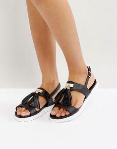 9aed56ab29e Get this Park Lane s flat sandals now! Click for more details. Worldwide  shipping. Park Lane Metal Trim Tassel Flat Sandals - Black  Shoes by Park  Lane