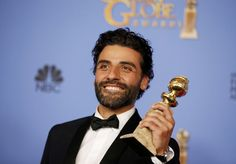 """Oscar Isaac poses with his Best Actor award for HBO's """"Show Me A Hero"""" at the 2016 Golden Globes"""