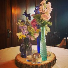 Spring themed centerpieces for a wedding reception at Homewood, Asheville Wedding Venue.  #ashevillewedding #homewoodwedding #ashevilleweddingvenue
