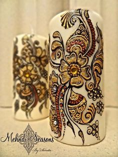 Rich gold flower pillar candles.  For more info or orders contact Sunita on:  T: 07843204974 E: info@mehndi-seasons.co.uk