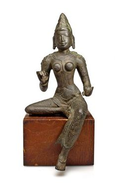 A copper alloy figure of Parvati  Tamil Nadu, Chola Dynasty, 11th century. 14 inches. Sold $72,100.