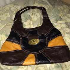 Brown patchwork bag Super cute, large hobo style bag. Good condition. Check out my other listings to bundle and save 25% 😎! Bags